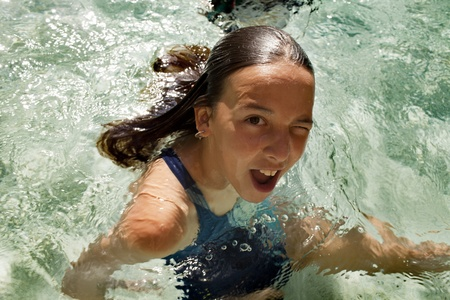 11 years: 11 years old caucasian girl is in the swiming pool Stock Photo
