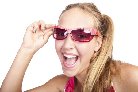 smiling beautiful caucasian girl  with hands which has colored nails holds her sunglasses photo