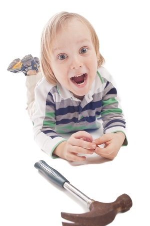 flatnose: boy is looking at hammer and pliers, isolated on a white Stock Photo