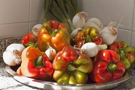 metall: colored big sweet pepper with onion on the metall dish Stock Photo