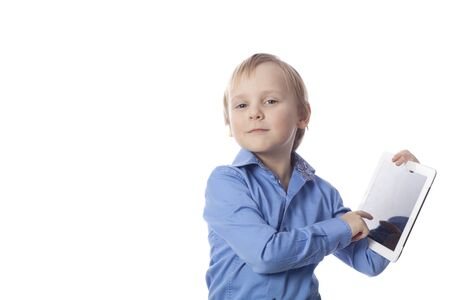 funny boy of 5 years old with touch pad isolated on a white photo