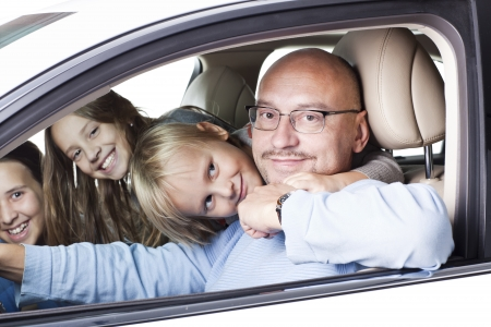 happy father with smiling children in the car photo