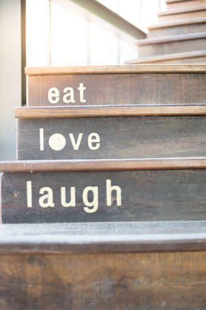 love life: wooden cafe stairs with word texts take at morning