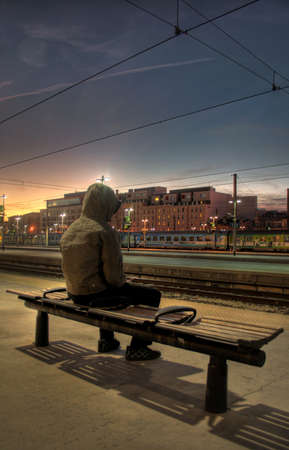 man waiting: Man waiting the train  Stock Photo