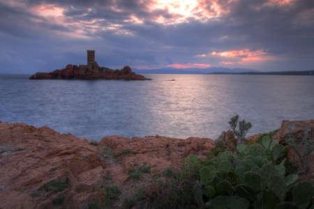 jus: Golden island at sunset