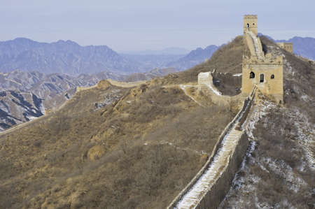 Sunlit view of the great wall of china during the winter Stock Photo