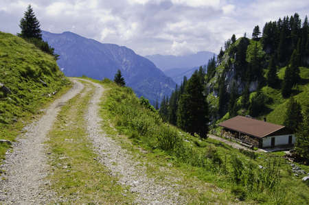 A mountainous dirt road in the german alps. Stock Photo