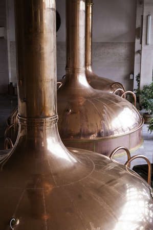 Copper holding tanks used to ferment beer during the brewing process