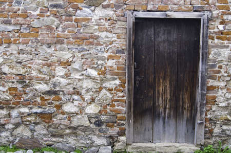 stone wall: An old rustic doorway in Europe.