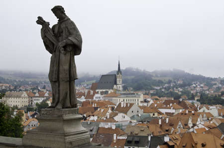 Statue over rooftops of european city Stock Photo - 10827753