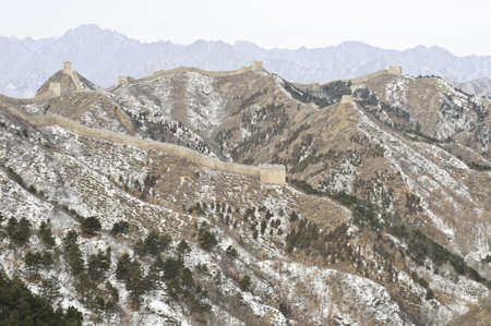 A distant view of the great wall of china during the winter Stock Photo