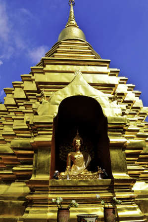 A golden wat with buddha in Chiang Mai, Thailand Stock Photo