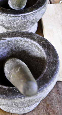 Two stone mortars and pestle used to grind spices in Thailand