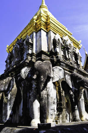 An old temple in Chiang Mai, Thailand with statues of Elephants photo