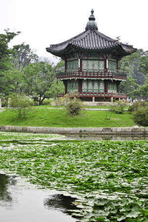 A garden pond with a Chinese style pagoda in the city of Seoul, Korea Editorial