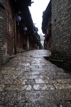 A narrow village street in a market in Lijiang, China in the Yunnan provence. Stock Photo - 10820556