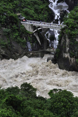 A bridge crossing a stream in Tiger Leaping gorge, Yunnan, China Editorial
