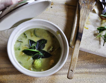 A small spicey green curry dish cooked at a cooking school in Thailand Stock Photo
