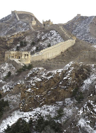 Distant view of the great wall of china with snow on the mountain Stock Photo