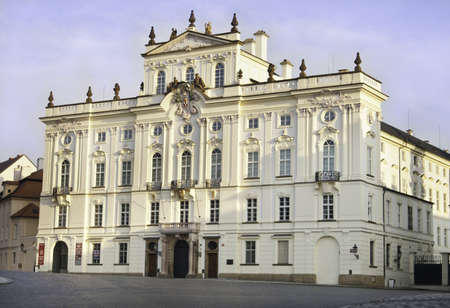 the white prague palace outside of the castle front gate