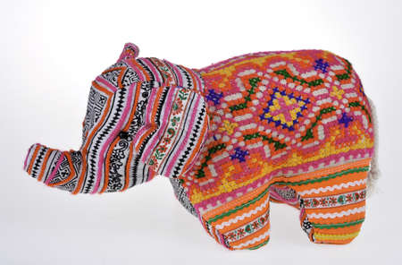 washable: A colorful stuffed elephant isolated on white background