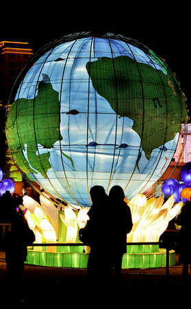 Large globe lantern at night in an asian park