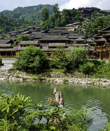 miao: Ethnic Chinese Miao village near a river in rural China