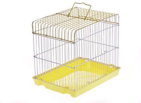 Empty Yellow bird cage side overlooking