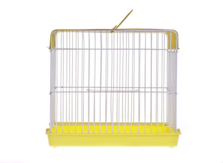 Empty golden bird cage  isolated on white Stock Photo