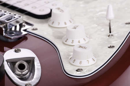 Detail of electric red and white guitar Stock Photo - 10865670