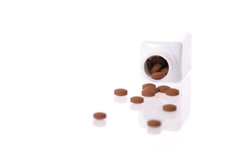 A white pill bottle with red generic pills  on a white background.