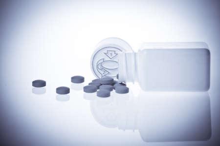 morbus: Pills near vintage bottle isolated on white