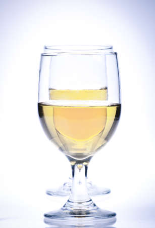 muscadet: Two Glasses of white wine Isolated on a white background.