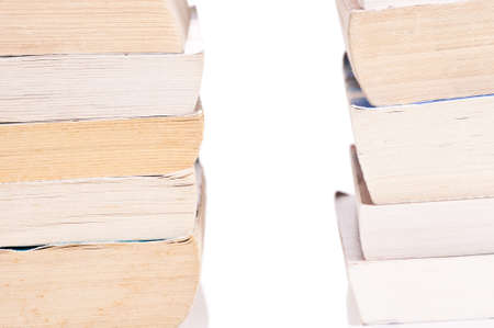 Two stacks of books on white background