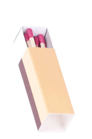 Matchbox with red matches isolated over white background