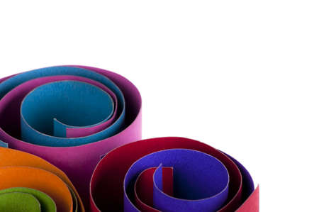 Multi-colored craft paper rolls isolated on white background