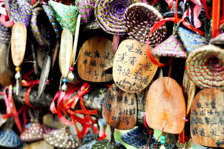 close-up of colorful wooden buddhist prayer tablets in lijiang, China also seen on the show