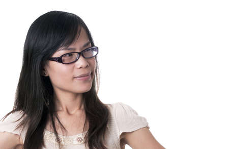 An confused female with black glasses and blak hair with hands on her hips against white background