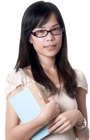 A young asian female holding a blue book while wearing glasses