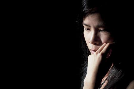 Beautiful Asian girl looking away in deep thought photo