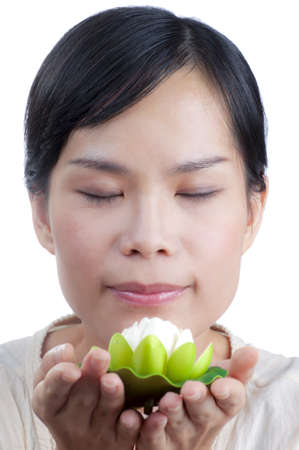 Asian woman holding and smelling beautiful white  lily flower with spa concept isolated