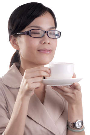 Asian business woman about to enjoy her morning cup of coffee before work isolated Stock Photo