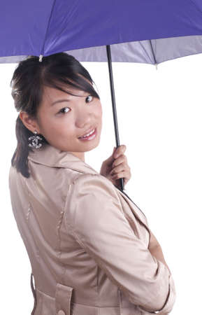 Asian business  woman holding purple umbrella isolated