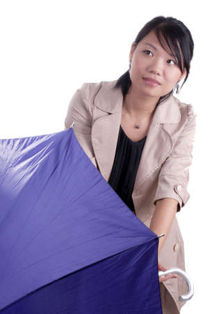 Young asian woman holding umbrella wondering if it will start raining