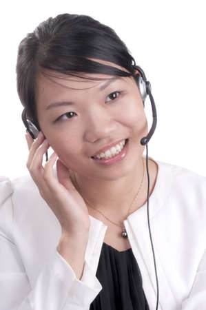 Asian customer service representative on headset phone with client Stock Photo