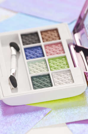 Eye shadow kit over colourful papaers background Stock Photo