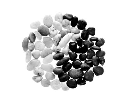 Yin Yang symbol made from beach pebble, isolated on white