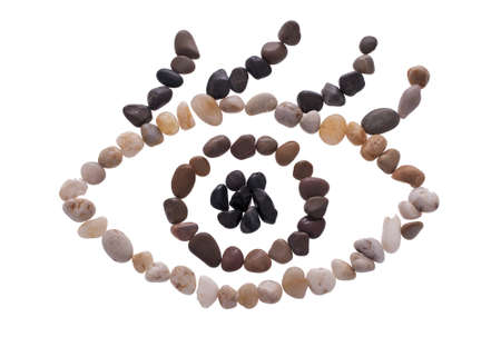 An eye symbol made out of small stones isolated on the white