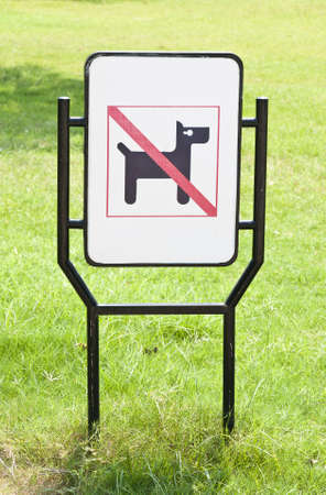No dogs pets allowed warning sign in the park Stock Photo