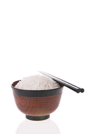 Bowl of cooked rice with chopsticks isolated on white background Stock Photo